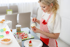 Happy woman baking in her kitchen Stock Photo
