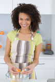 Happy woman baking in kitchen stock photography