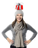 Happy woman balancing a Christmas gift on her head Stock Image