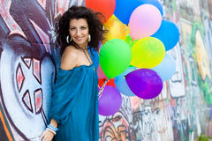 Happy woman with balloons Stock Photos