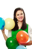 Happy woman with balloons Stock Images