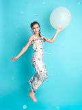 Happy woman with balloons on blue background royalty free stock image