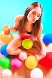 Happy woman with balloons and cocktail at poolside. Happy woman having fun with balloons and cocktail drink alcohol. Pretty attractive girl relaxing at swimming Stock Images