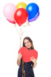 Happy woman with balloons hugging heart Stock Photo