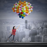 Happy woman with balloons Stock Photography