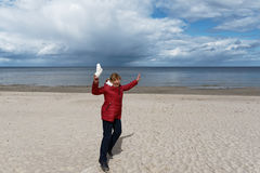 Happy woman at Baltic sea. Royalty Free Stock Photography