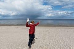 Happy woman at Baltic sea. royalty free stock photography
