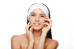 Happy Woman after Bath with Clean Perfect Skin. Young Woman in Hairband Touching her Face with a Perfectly Clean Skin. Happy Woman after Bath with Clean Perfect stock images