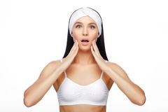 Happy Woman after Bath with Clean Perfect Skin. Young Shocked Woman in Hairband Touching her Face with a Perfectly Clean Skin. Shocked Woman after Bath with royalty free stock images