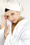 Happy woman in bath robe smiling Royalty Free Stock Images
