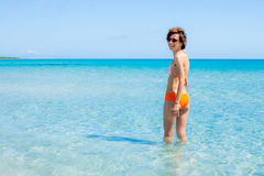 Happy woman bathing in a clear sea royalty free stock photography