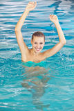 Happy woman bathing in swimming pool Royalty Free Stock Photos