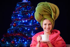 Happy woman in bathrobe holding cup of tea Stock Photo