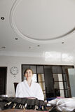 Happy woman in bathrobe Royalty Free Stock Photo