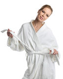 Happy woman in bathrobe Stock Photos