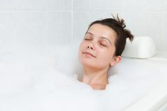 Happy woman in bathtub Stock Images