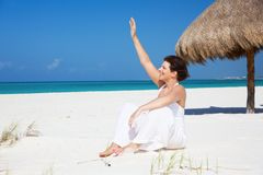 Happy woman on the beach Stock Image