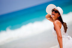Happy woman at the beach Royalty Free Stock Image