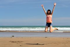 Happy woman on the beach. Woman jumping on the beach Royalty Free Stock Photo