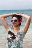 Happy woman on the beach stock photos
