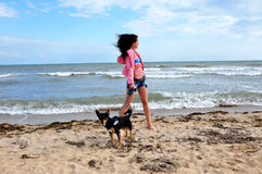 Happy woman on beach with dog, independence day usa Royalty Free Stock Images