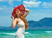 Happy woman at the beach enjoying her summer holidays Stock Photography