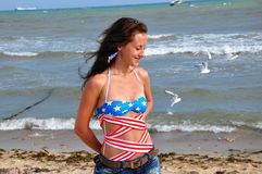 Happy woman on beach, independence day usa Royalty Free Stock Images