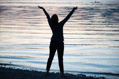 Happy woman on beach Stock Image