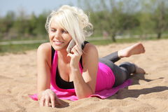 Happy woman on the beach with mobile phone Stock Photo