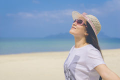 Happy woman on the beach. Stock Image
