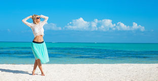 Happy woman on the beach in tropical island Royalty Free Stock Photography