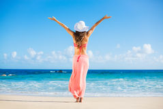 Happy woman at the beach Stock Photography