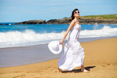 Happy woman on beach vacation Stock Image