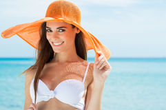 Happy Woman At Beach. With White Bikini And Orange Hat Stock Images