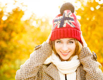 Happy Woman in Beanie Hat on Autumn Background royalty free stock photography