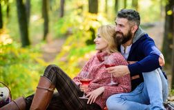 Happy woman and bearded man drink wine. couple in love relax in autumn forest. camping and hiking. cheers. love date and stock photo