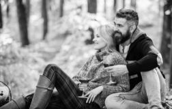 Happy woman and bearded man drink wine. couple in love relax in autumn forest. camping and hiking. cheers. love date and royalty free stock image