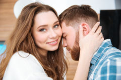 Happy woman and bearded man hugging gently Royalty Free Stock Photos