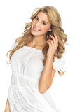Happy Woman. Happy beautiful Caucasian blond woman in white summer fashion dress Stock Image