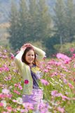 Happy woman in a beautiful flower field. Stock Photography