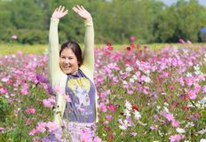 Happy woman in a beautiful flowers field. Royalty Free Stock Photos