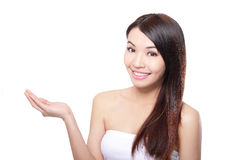 Happy woman with beautiful hair introduce Stock Images