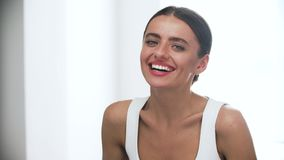 Happy Woman With Beautiful Smile In White Interior