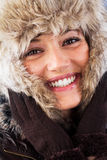 Happy woman with a beautiful smile in winter Royalty Free Stock Image