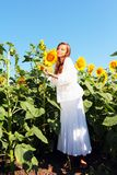 Happy woman in beauty field. With sunflowers Stock Image