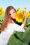 Happy woman in beauty field. With sunflowers Stock Photography