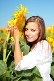 Happy woman in beauty field. With sunflowers Royalty Free Stock Photo