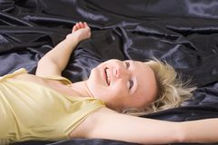 Happy woman on the bed Royalty Free Stock Image
