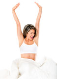 Happy woman in bed Royalty Free Stock Image