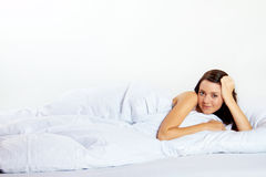 Happy woman in bed Royalty Free Stock Images